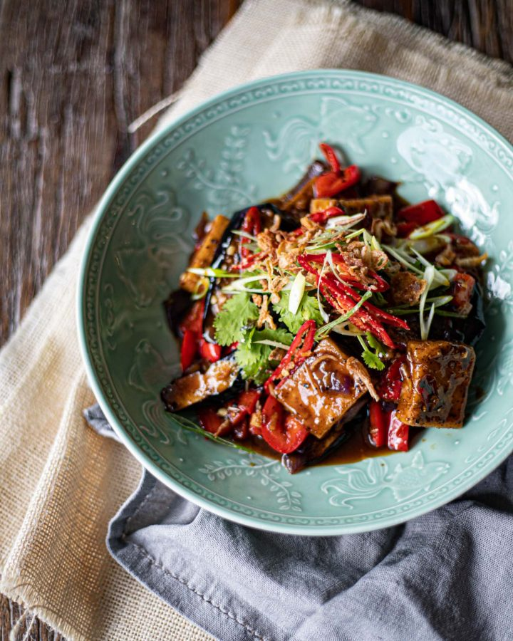 a dish of black pepper tofu with eggplant and chillies